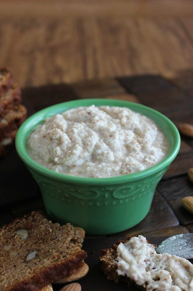 Homemade Almond Mayonnaise centered in a green bowl and spread on pear bread.