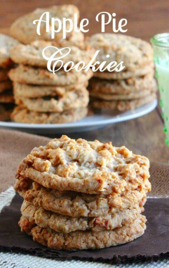 Apple Pie Cookies stack in a stack of 4 in front of a big plate of multiple stacks of 5 cookies high.