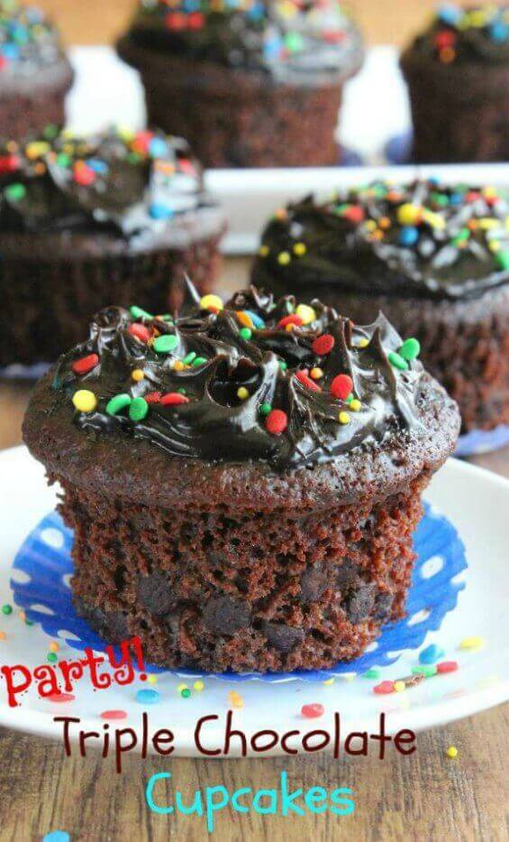 Party Triple Chocolate Cupcakeswith one big cupcake right in front and sprinkled with colorful confetti sprinkles.