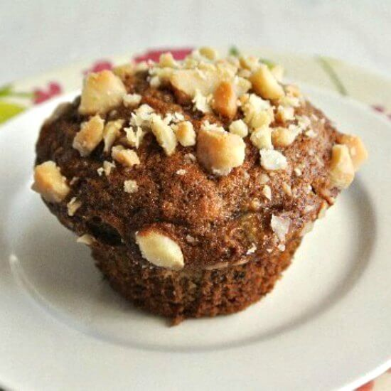 Small square photo of a macadamia nut covered muffin.