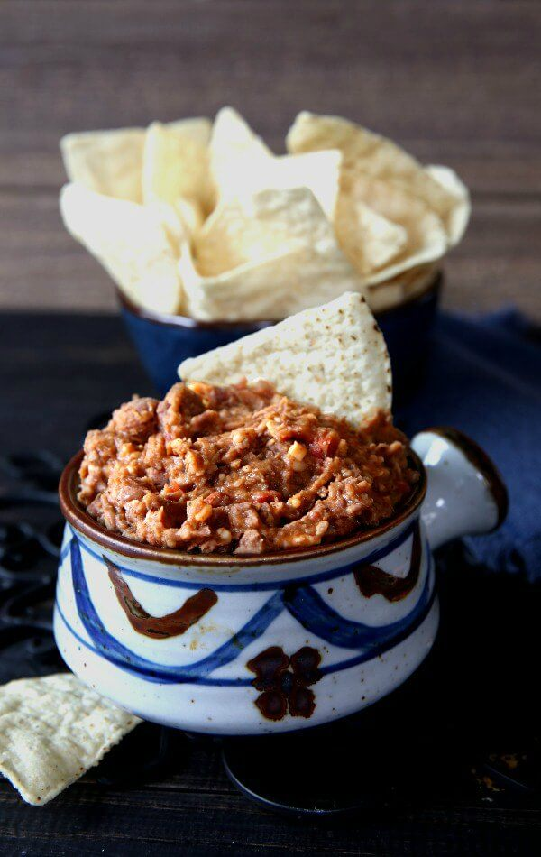 Hot Pinto Bean Dip is an American go-to when it comes to throwing a party. Everyone loves it & this one adds a little bit more - spices and cheese.