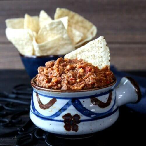 Hot Bean Dip is a Mexican pottery bowl in blues and browns.