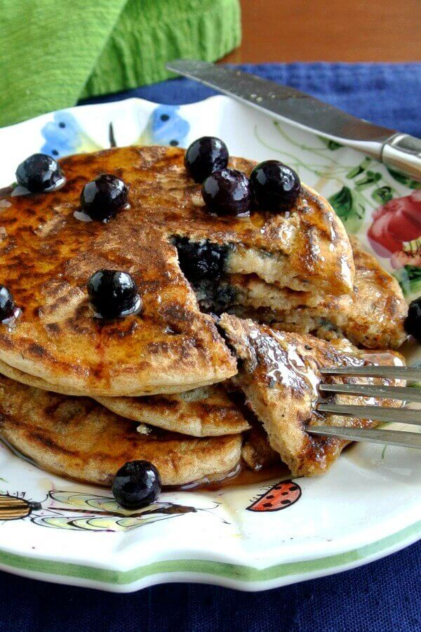 Dairy Free Blueberry Pancakes! Two simple words that mean so much. This recipe has healthier ingredients and big fat blueberries to boot.