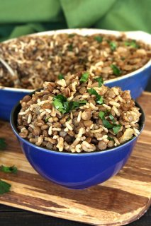 Classic rice, lentils, onion and spices mounded in a cobalt blue bowl and tilted forward.