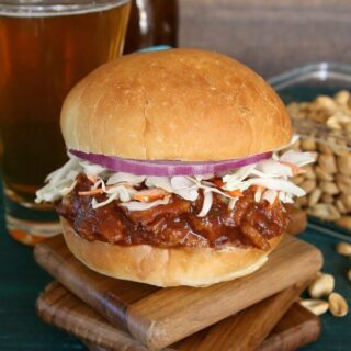 Texas BBQ Sausage Seitan Sandwich is crazy flavorful. Besides vegetables there are six herbs and spices added to the mix . Serve on a big bun and then take a big bite.