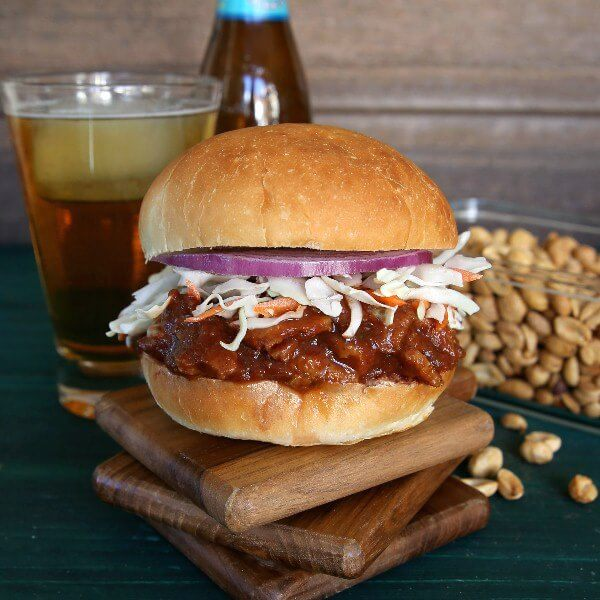 Texas BBQ Sausage Seitan Sandwich is spicy delicious! Besides vegetables there are six herbs and spices added to the mix . Serve on a big bun and then take a big bite.