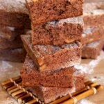 Irish Blackberry Cakes are square cakes and are stacked high with the top two being broken in half for a look inside.
