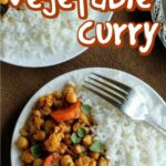 Two plates with half curry and ha;f rice with a fork on the side.Text above for pinning.