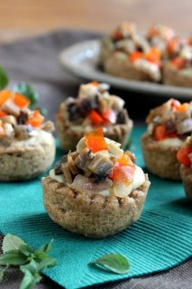 Garlic Hummus Stuffed Mini Bread Bowl is a scalloped baked whole wheat cup that's filled with hummus and sprinkled with sauteed mushrooms and red bell peppers.