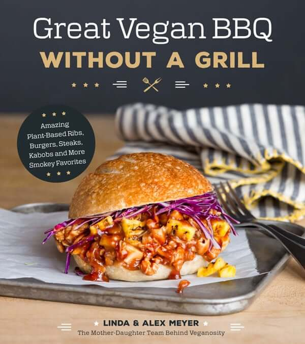 Boneless BBQ Buffalo Wings are inside the cookbook titles. Great Vegan BBQ Without a Grill. On the cover is an oozing plant based burger of saucy veggies and purple cabbage.