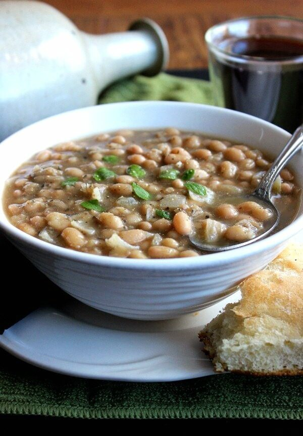 White Bean Chili is centered and pictured close up to show all the veggies and spices swirling in the broth