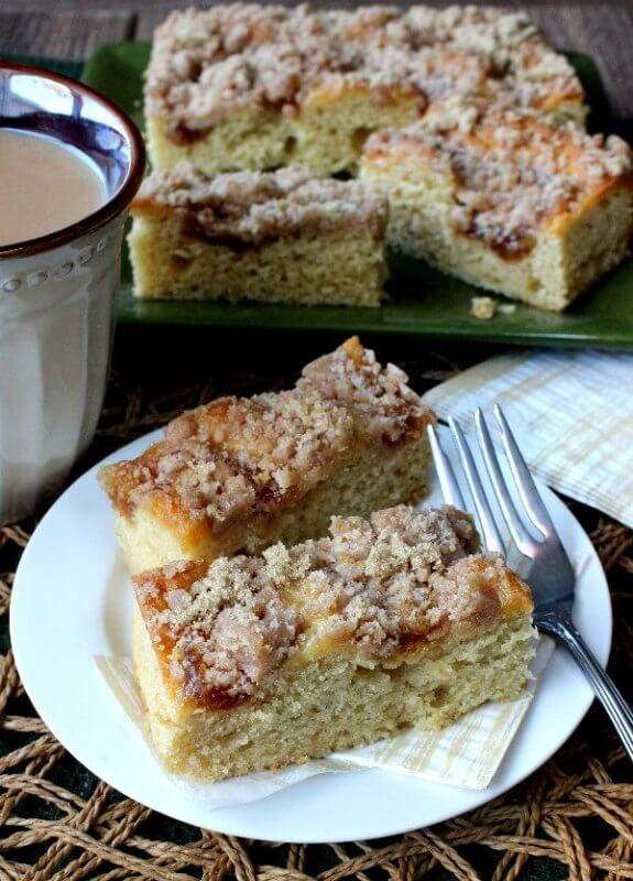 Vegan Coffee Cake with Apple Cinnamon Streusel is tilted forward with two slices sitting on a white plate with a fork at the ready.