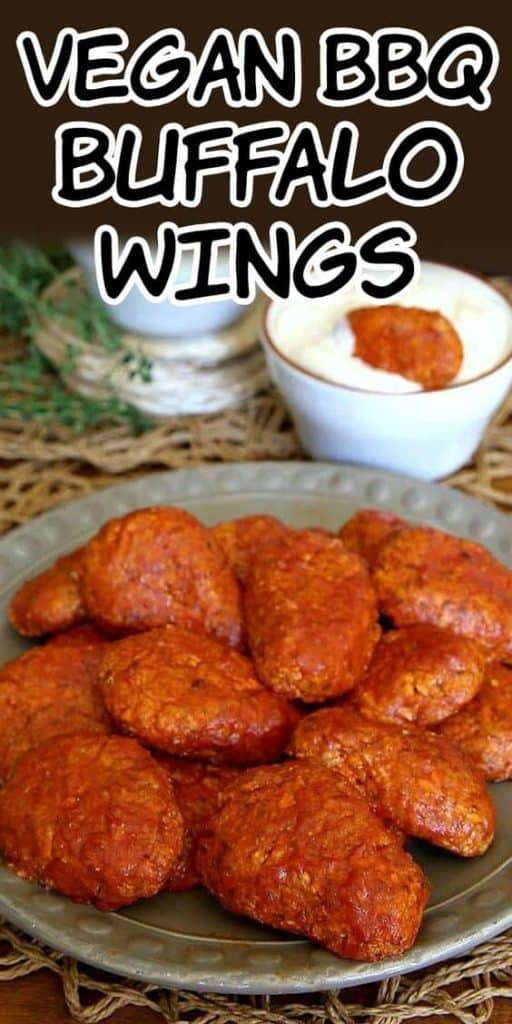 pile of rich vegan buffalo wings on a plate.