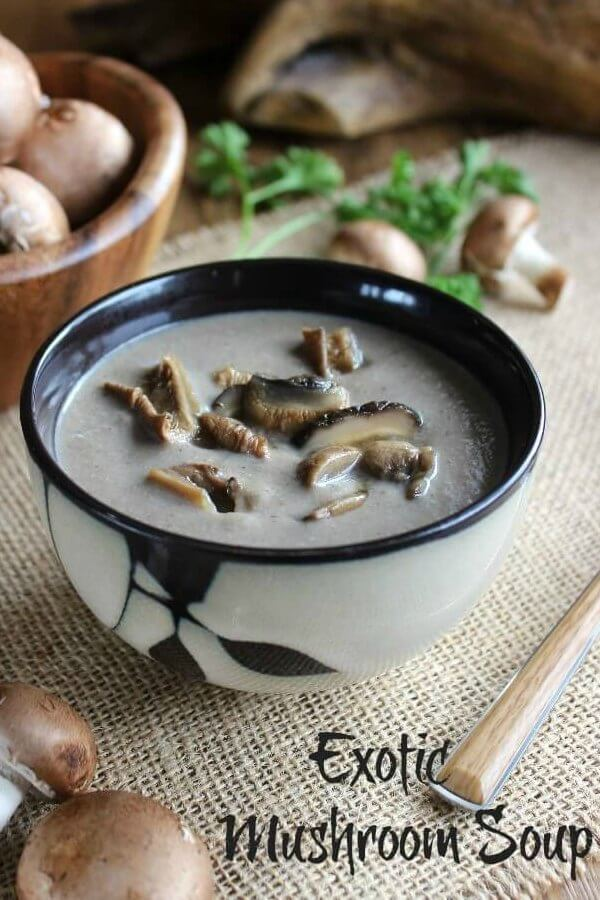 Slow Cooker Exotic Mushroom Soup is in an Asian black and beige bowl that sets off the color of the soup with full sliced mushrooms.
