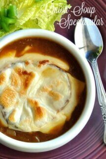 Homemade French Onion Soup with an overhead view of a rich brown onion soup topped with a slice of French bread and melted vegan cheese. In a white bowl against a deep purple background.