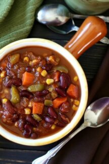Caribbean Chili is features as an overhead photo with the lovely colors of kidney beans, carrots, corn and green bell pepper. It's all being served in an orange handled bowl.