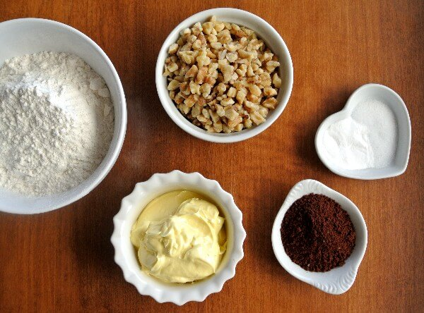 Five of the vegan chocolate cookie ingredients in various shapes and sizes small white bowls.