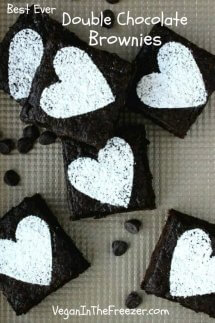 Best Ever Double Chocolate Brownies are an overhead view of brownie squares with sugar hearts on top.