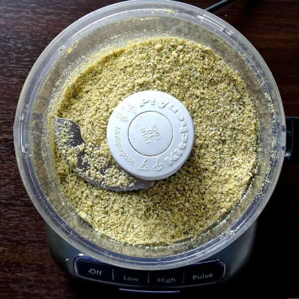Nut Free Vegan Parmesan Cheese has 5 ingredients and they are all in a food processor and ground to a perfect sprinkling size.