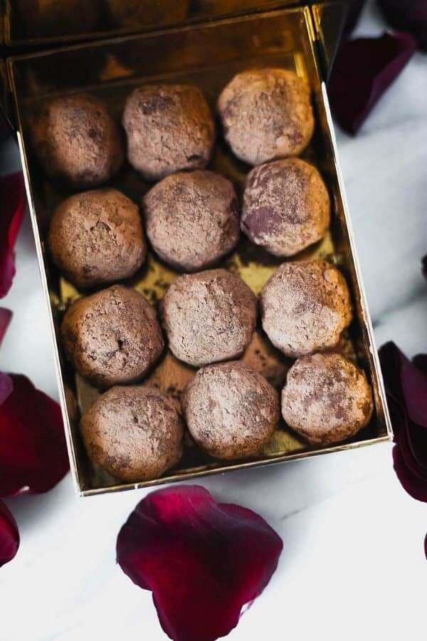 Chocolate Macadamia Truffles are boxed 3x4 and dusted with cocoa powder.