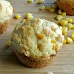 Vegan Cornbread Muffins with one closeup of a corn filled muffin.