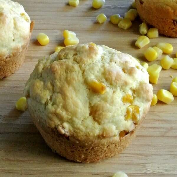 Vegan Cornbread Muffins with one closeup of a corn filled muffin.