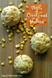 Vegan Cornbread Muffins photographed from overhead on a wooden cutting board with corn sprinkled around. Title text too.