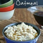 Slow Cooker Irish Oatmeal is filling a blue porcelain bowl with maple syrup drizzled over the top. Text at top for social sharing.