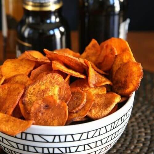 Air Fryer Sweet Potato Chips are overflowing a geometric black and white bowl.