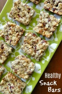 Overhead photo and close-up up healthy snack bars cut into squares and showing cranberries and dates.