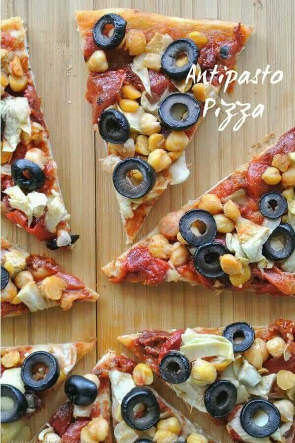 Overhead view and closeup of sliced of pizza on wooden board.