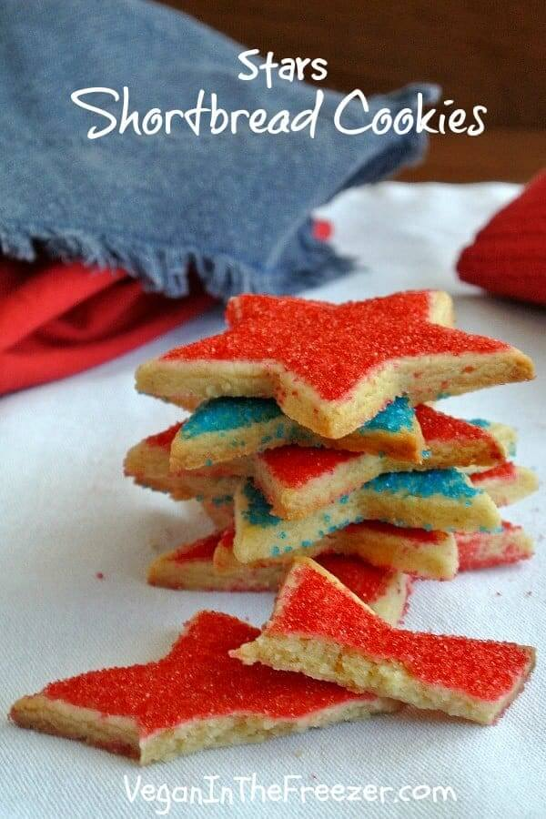 Stack of six stars shortbread cookies sitting at all angles and covered with red and blue sugar.