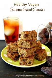 Stack and pile of banana bread squares infront of a glass of iced tea and a jar of spilled dates.