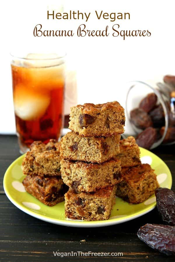 Stack and pile of breakfast squares infront of a glass of iced tea and a jar of spilled dates.