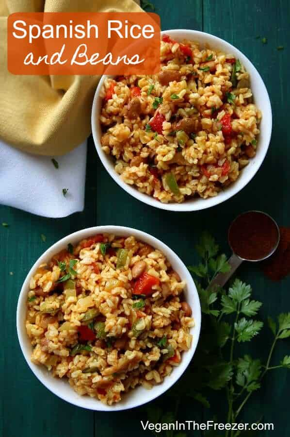 Overhead photo of two bowls of colorful Spanish rice with beans.
