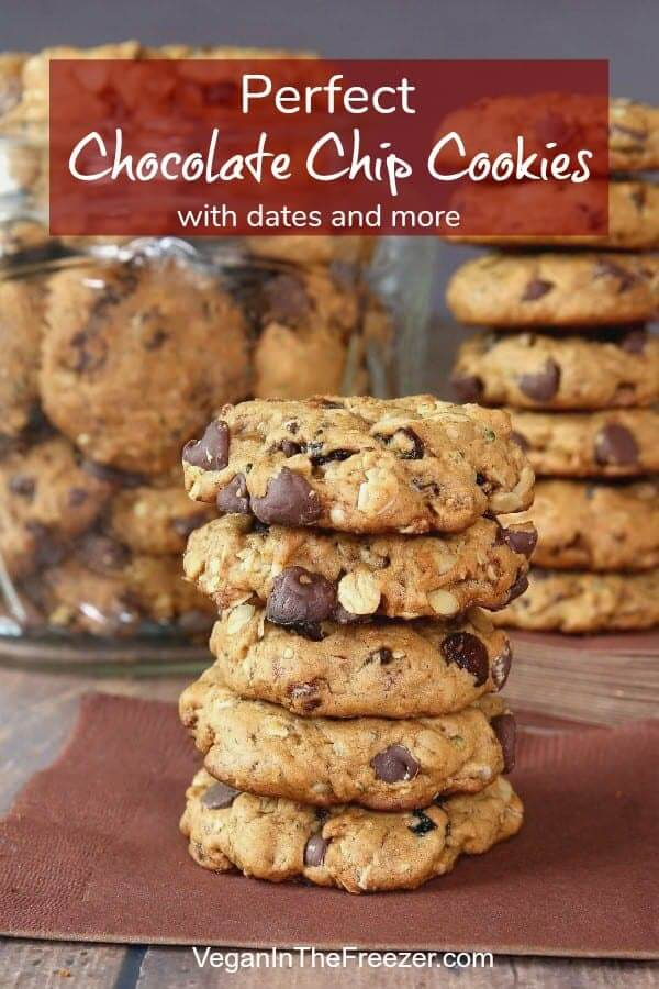 Five cookies are stacked high on a brown napkin with chocolate chips bulging out the sides.