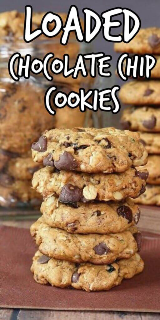 Stack of five chocolate chip cookies with a jarful behind.