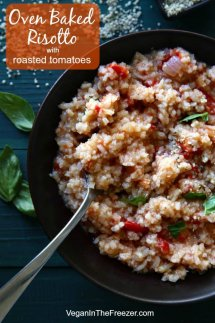 Overhead view of creamy risotto and tomatoes in a black bowl with a spoon inside for the scooping. Text above.