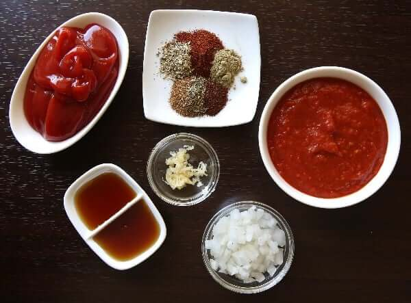 Ingredients in individual white and clear bowls for spicy homemade BBQ sauce.