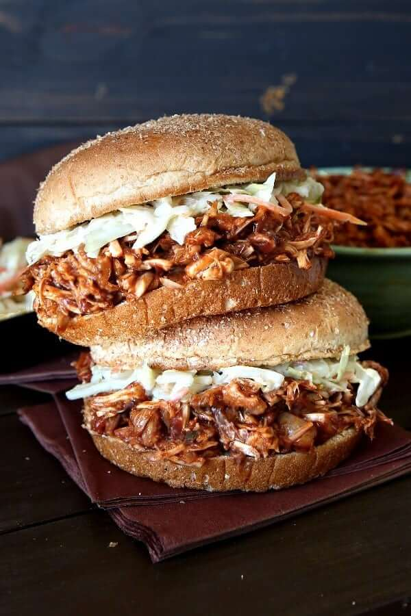 Front view of two sandwiches stacked on to of each other with filled with bbq pulled jackfruit.