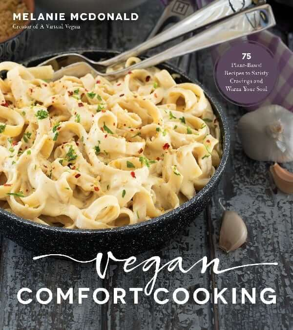 Cover of a cookbook title Vegan Comfort Cooking with a photo of Alfredo Fettuccine on the cover.