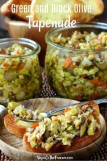 Olive Tapenade is piled on crostini toasts with filled jars behind.