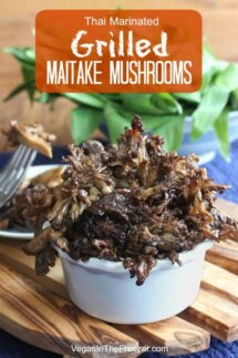 Front view of marinated Maitake mushroom side dish sitting on a wooden trivet.