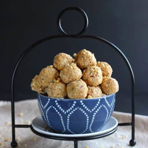 Square photograph of peanut butter balls in a blue and white bowl.