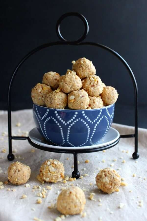 Front photo of peanut butter balls spilling over onto a beige cloth.