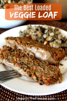 Two slices of Vegan Meatloaf with gravy and mushroom stuffing on a white plate.