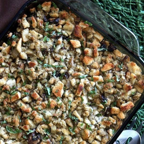 Overhead casserole dish full of stuffing cropped square.