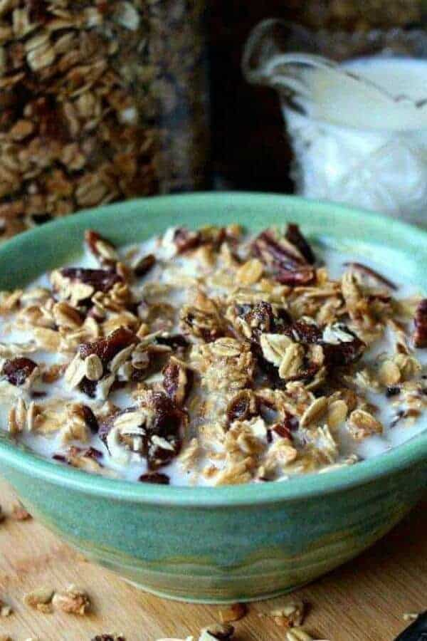 Close up photo and cropped on each side of the bowl filled with granola and milk.