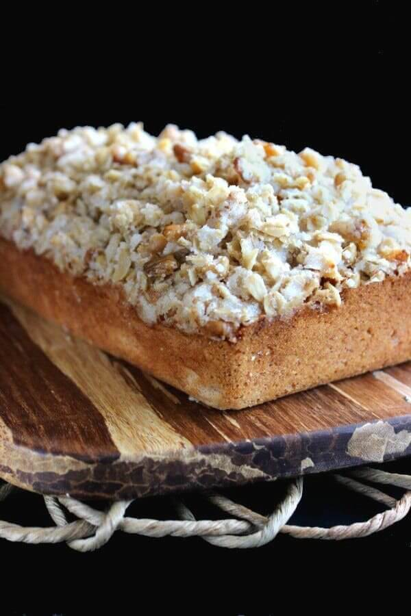 close up angle of a loaf of banana bread covered with cereal streusel.