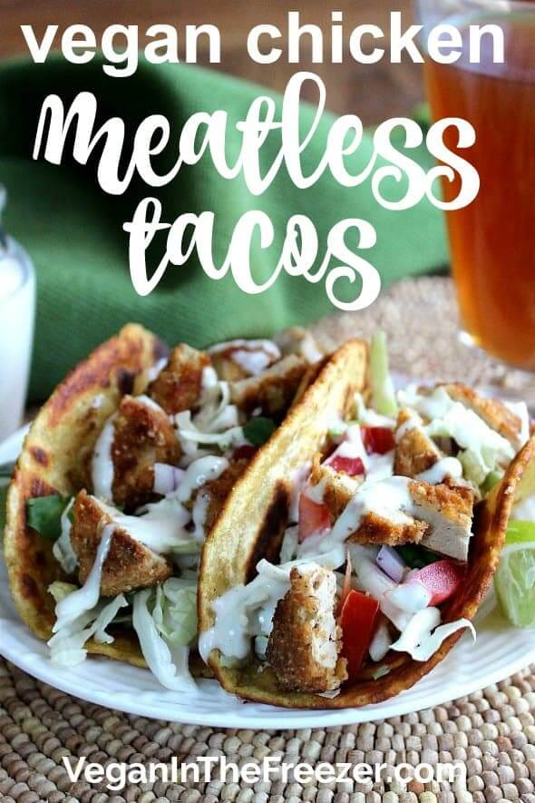 Front view of two tacos side by side and filled with veggies and meatless chicken with text at the top.